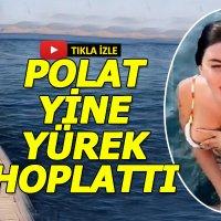 Şarkıcı Ebru Polat'ın denize elbise ile girmesi